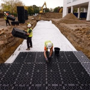 picture of builders installing polypipe polystorm R soakaway crates